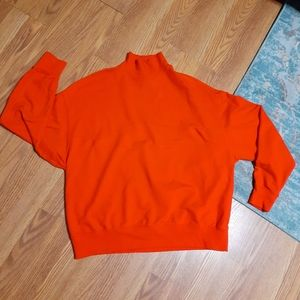 Red mockneck sweatshirt
